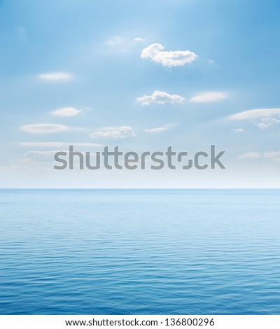 blue sea and cloudy sky over it #136800296