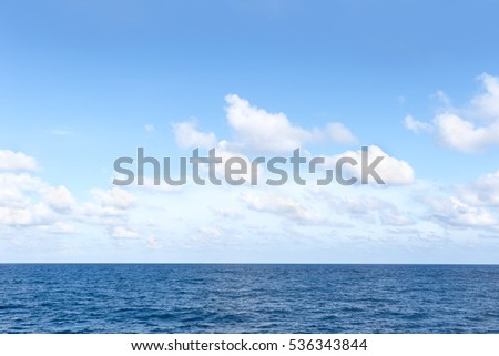 blue sea and cloudy sky over it #536343844