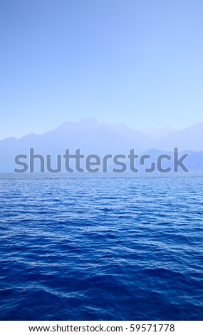 Blue sea and mountain - stock photo