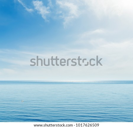 blue sea and sky with clouds #1017626509