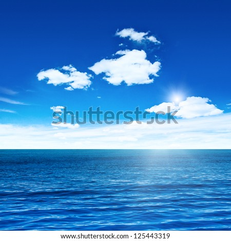 Blue sea and sky with sun. Sea summer shot