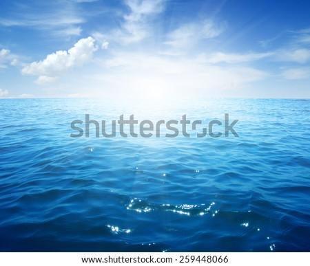 Blue sea and sun on sky - Shutterstock ID 259448066