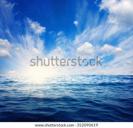 Blue sea and sun on sky #352090619