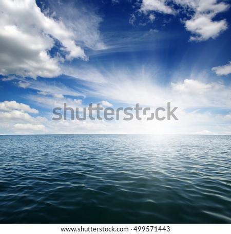 Blue sea and sun on sky #499571443