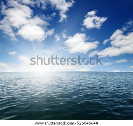Blue sea and sun on sky #526046644