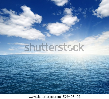 Blue sea and sun on sky #529408429