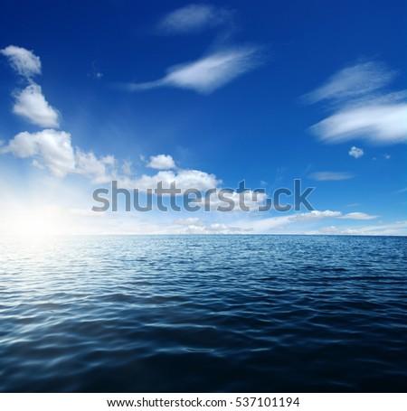 Blue sea and sun on sky #537101194