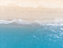 Blue sea and white sand beach in summer landscape for web advertisment and poster background.Aerial view of seashore coastline by drone