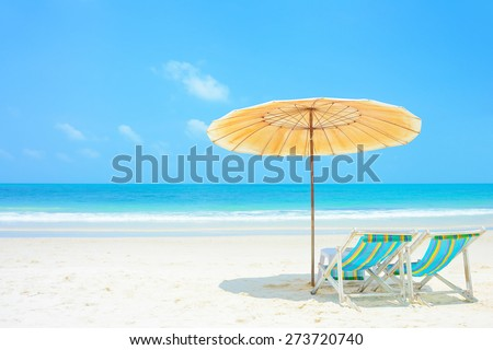 Blue sea and white sand beach with beach chairs and parasol, Samed island, Thailand - holiday and vocation concepts
