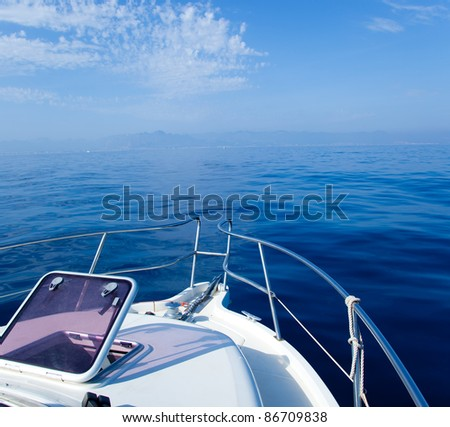 Blue sea boat sailing with open bow porthole in summer vacations