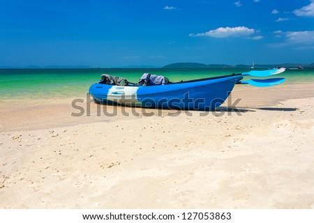Blue sea kayak on the tropical beach