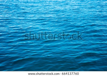 Blue sea surface with waves #664137760