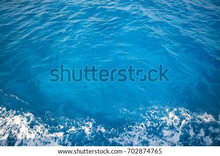 Blue sea, top view, foam , aquamarin color #702874765