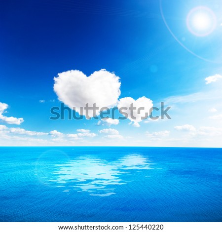Blue sea under clouds sky with heart shape cloud. Valentine background
