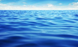 Blue sea water. Ocean surface natural background on sky
