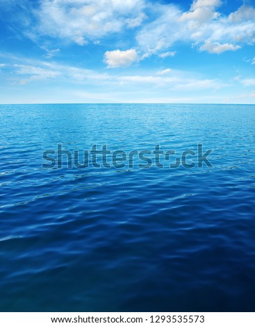Blue sea water surface on sky #1293535573