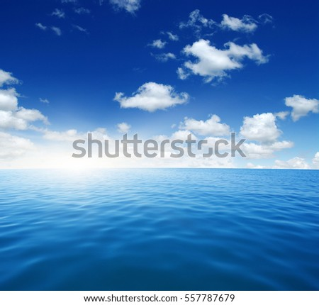 Blue sea water surface on sky #557787679