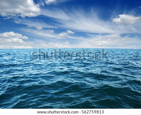 Blue sea water surface on sky #562759813