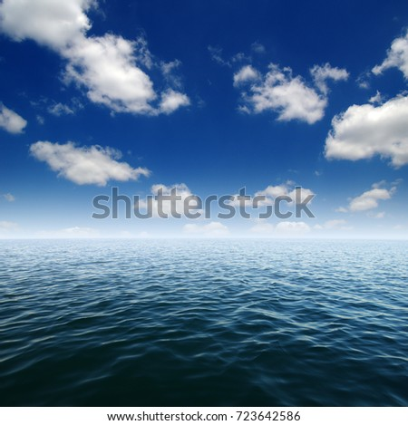 Blue sea water surface on sky #723642586