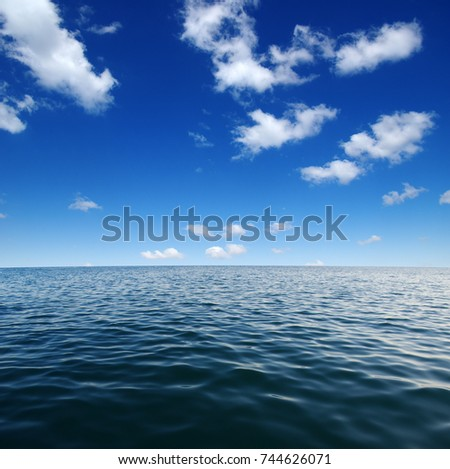 Blue sea water surface on sky #744626071