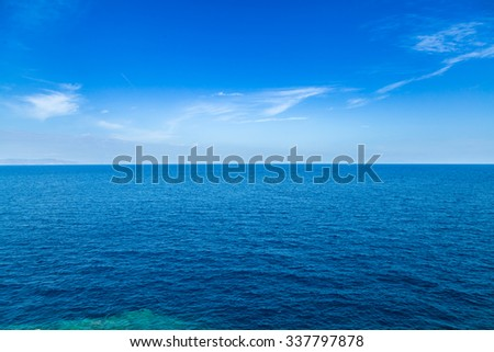 Blue sea waters and clear blue sky horizon #337797878