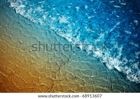 Blue sea wave and sand