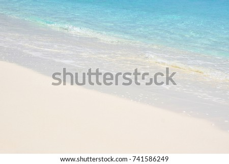 blue sea wave and white sand beach #741586249