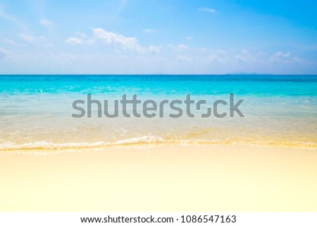 Blue sea wave on sand beach. Summer holiday relax background with copy space.
