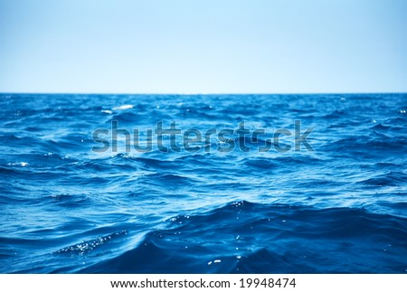 Blue sea waves closeup view.