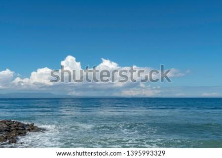 Blue sea with beautiful clouds in Candidasa Bali Indonesia #1395993329