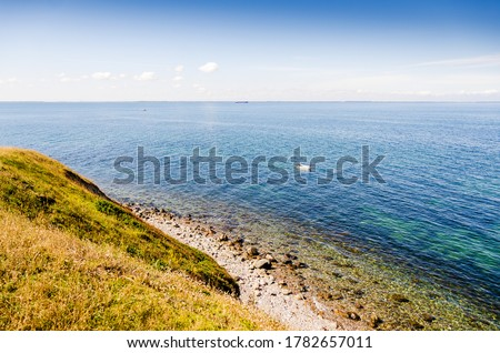 Blue sea with cliffs down to the beach in Fyns hoved, Denmark. Stockfoto ©
