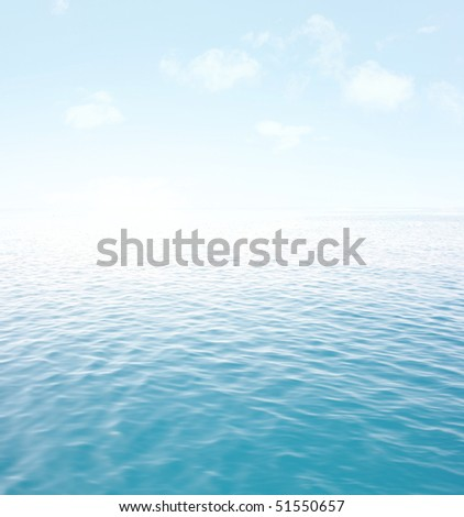 Blue sea with waves and sky with airy clouds