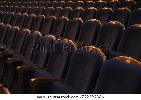 Blue seats at the theater. Comfort seat. Rows of blue seats in the auditorium. Theater, cinema or circus. #722392366