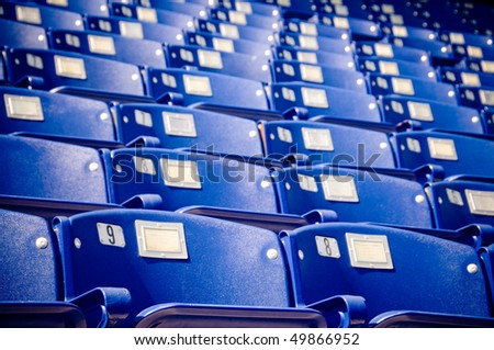 Blue seats at the US Naval Academy in Annapolis - stock photo