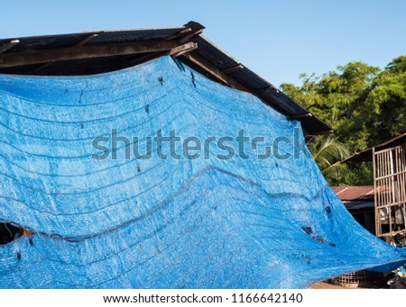 Blue shading net is covering the terrace of the countryside house for protect from the hot temperature in Thailand. #1166642140
