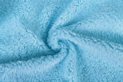 Blue shaggy blanket soft texture background.Fluffy fake textile fur polyester fabric.