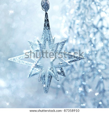 blue shiny star. christmas or new year decoration. abstract background