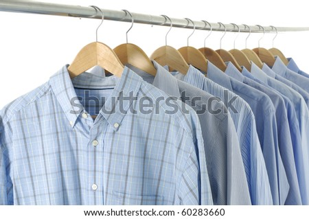 blue shirt clothes hanging in shop