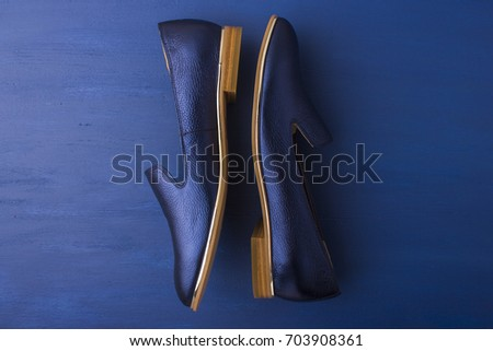 Blue shoes on a blue background. Women's shoes