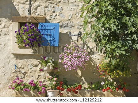 Blue shutter, house in French Village. Provence. France.