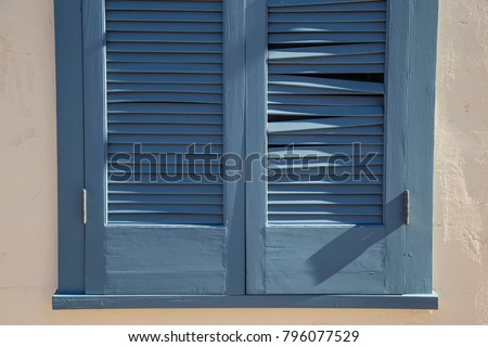 Blue shutter stucco wall spanish style architecture background texture wallpaper brown desert southwest old broken vintage