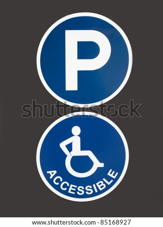 Blue Signs for Parking for Handicapped People on Grey Background