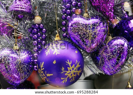 blue silver colored christmas decoration baubles with texture on a christmas tree