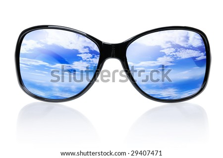 Blue skies and sea reflecting in sunglasses isolated on white background