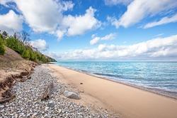Blue skies over a beach along Lake Michigan in northern Michigan
