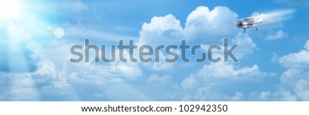 Blue skies with bright sun and airplane as abstract backgrounds - stock photo