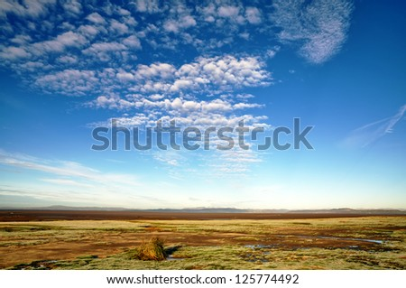Blue sky and altocumulus clouds over Morecambe Bay