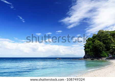 Blue sky and clear water. The White Beach, Puerta Galera, Philippines.