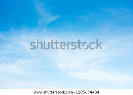 blue sky and cloud.blue sky back ground. Sky on a bright day. The softness of the clouds and the brightness of the sky. Light blue background.Bright blue background. Relaxing feeling like being in the #1205694484