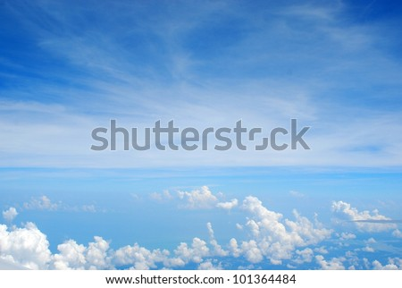 Blue sky and Clouds looking through window window of the Airplane